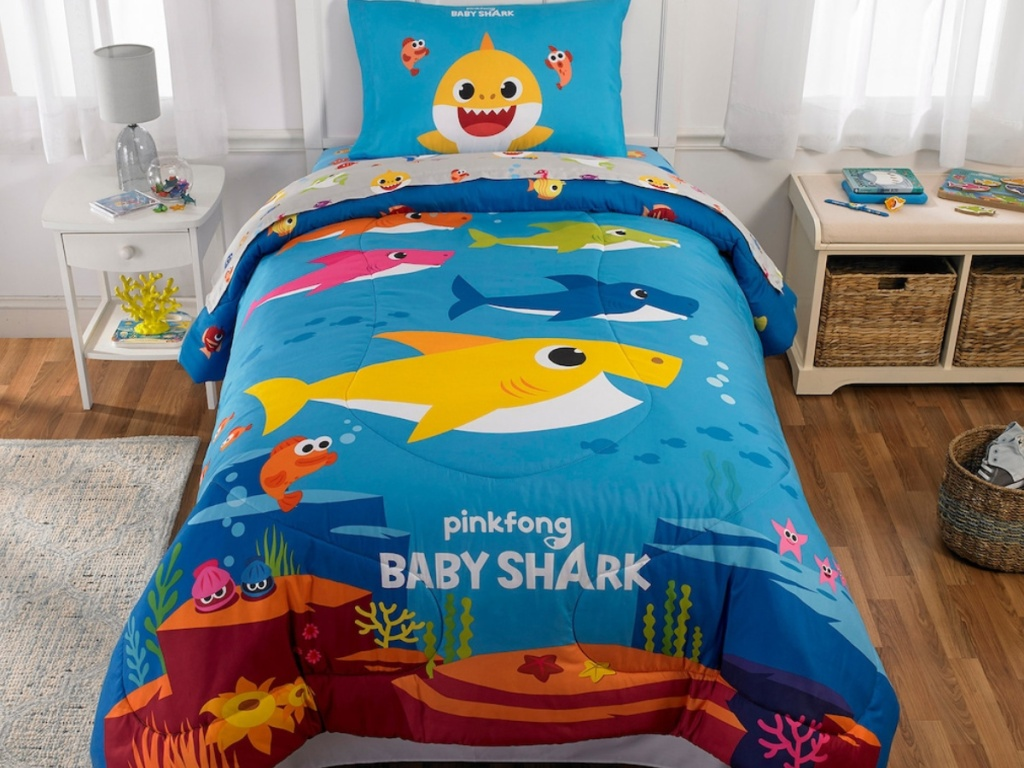 Pinkfong Baby Shark Comforter on bed in childs room