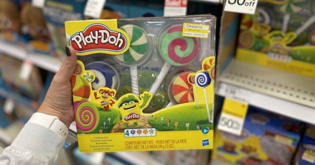 hand holding a Play-Doh Lollipop box