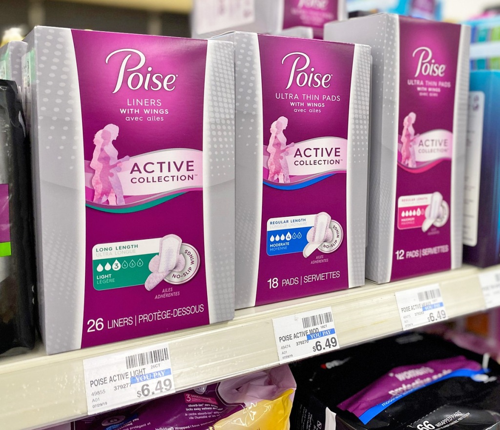 three pink and grey boxes of poise active collection pads and liners on store shelf