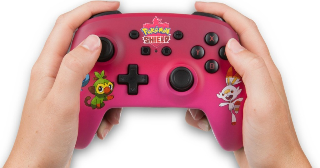 hands holding a Nintendo Switch controller