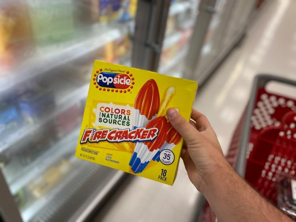 man holding box of popsicle firecracker in store