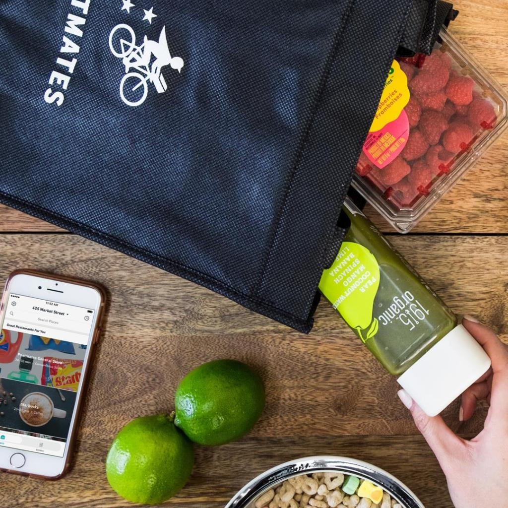 hand reaching into a postmates bag