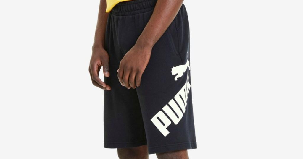 Man wearing Puma Shorts