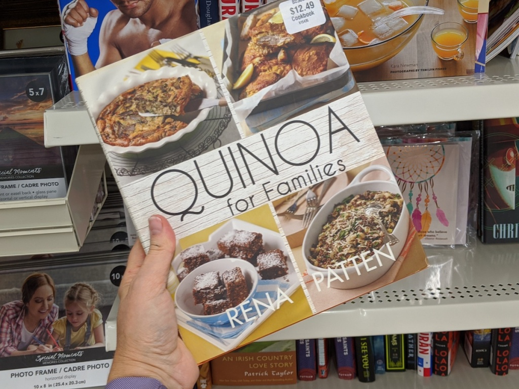 hand holding a Quinoa for Families book