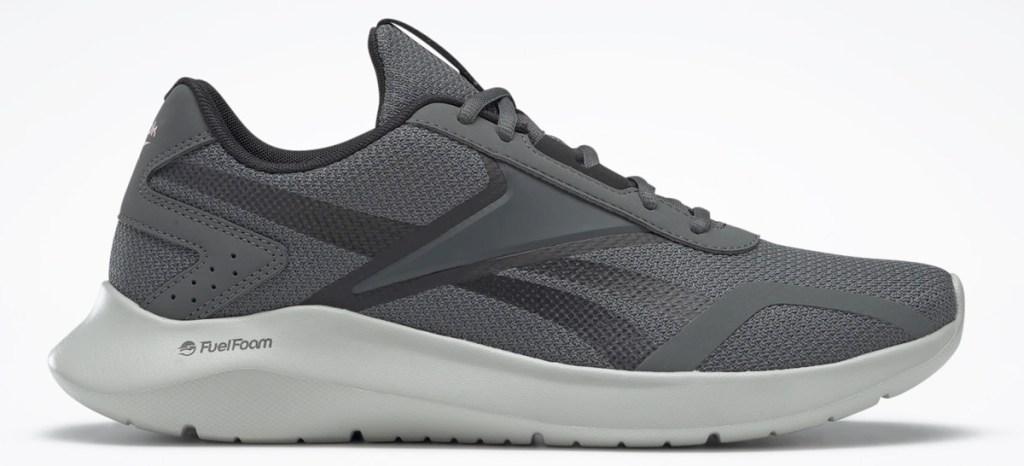 grey reebok running shoe with white foam sole