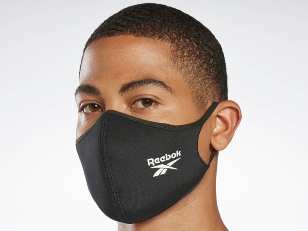 man wearing a black reebok face mask covering