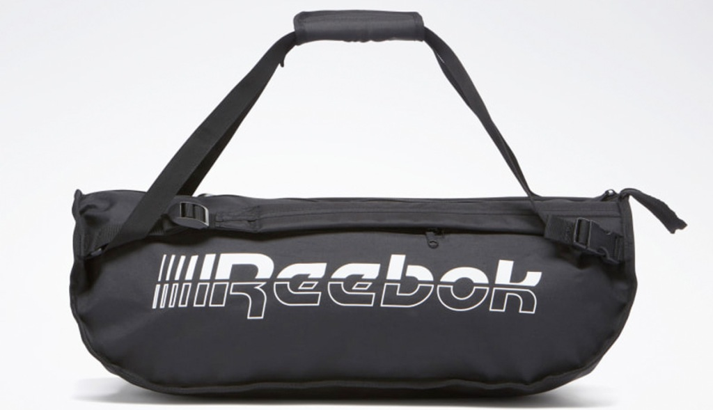 black duffel bag with white text that says reebok on the side
