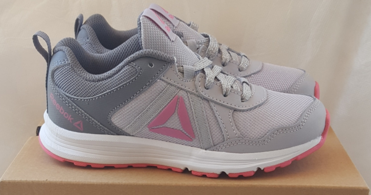 kids gray and pink sneakers on shoe box