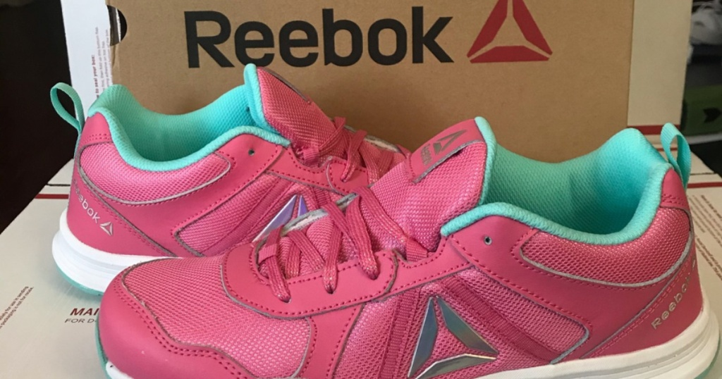 pink and blue kids shoes next to shoe box