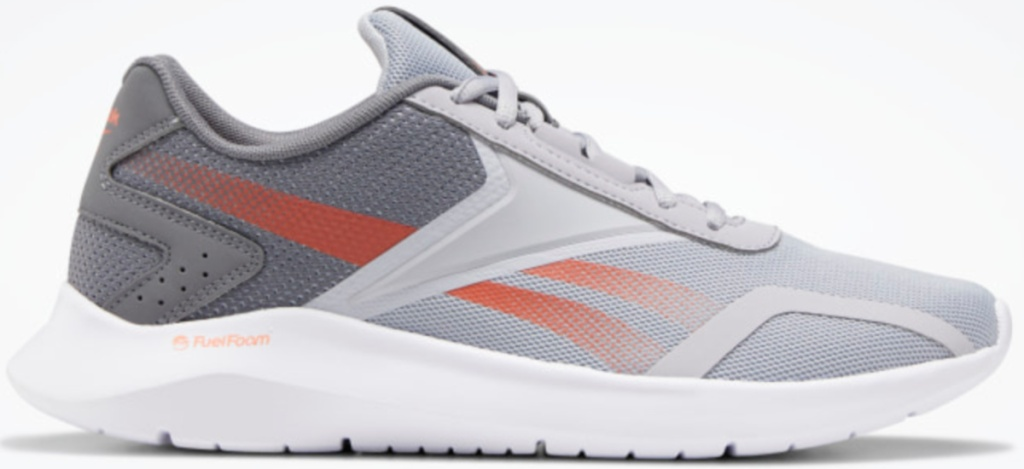 grey and orange colored reebok shoes