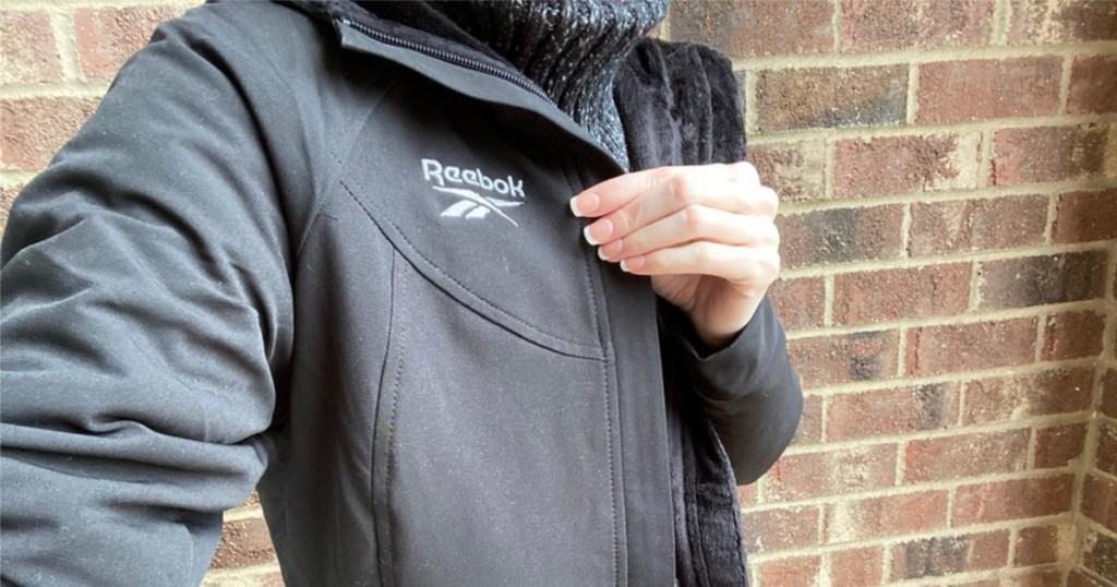 woman wearing black fur lined jacket