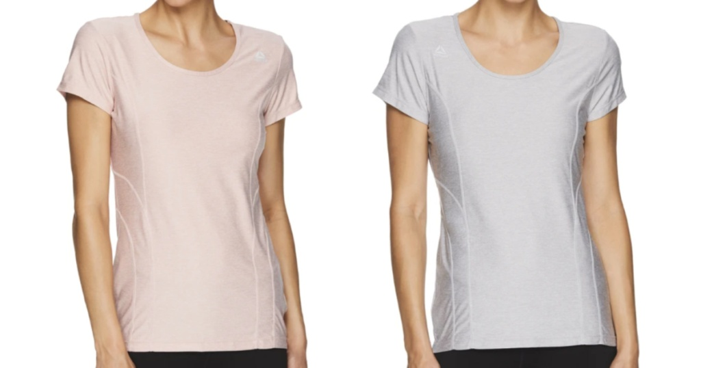 2 women standing next to each other wearing short sleeve t-shirts