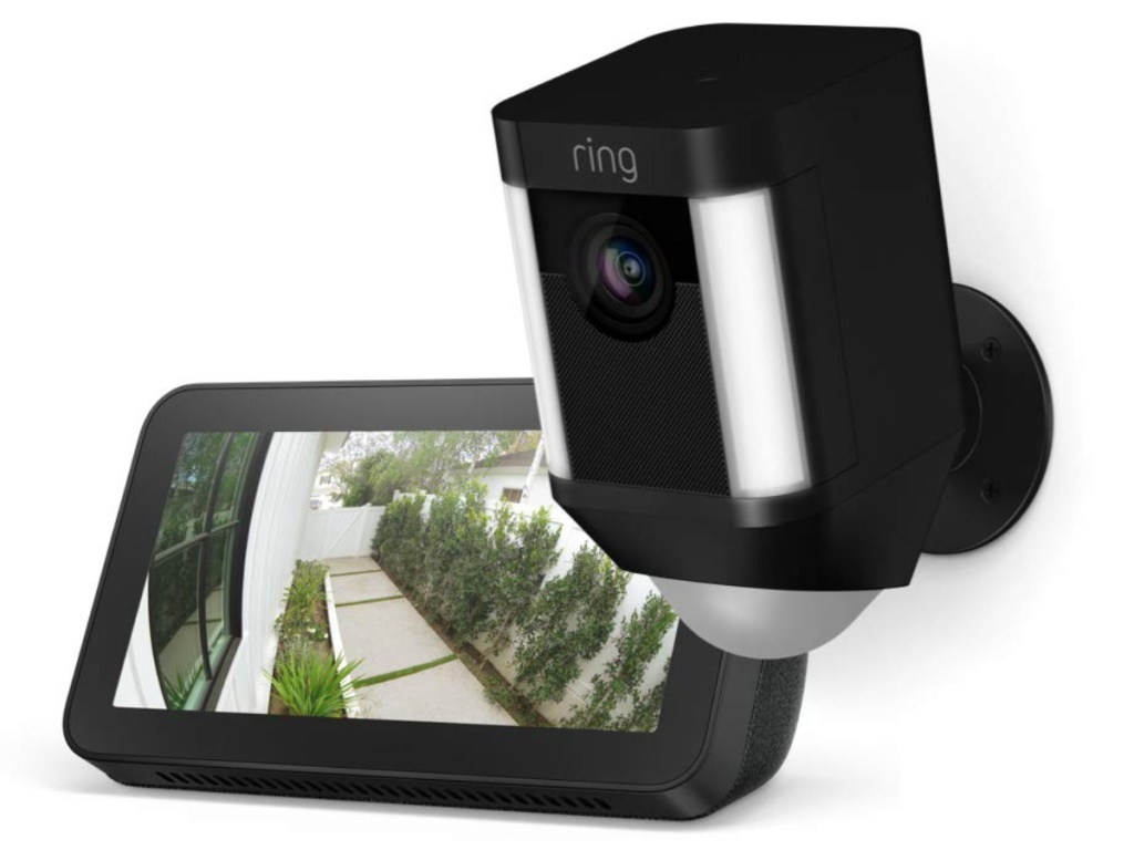 black smart security camera and black smart device showing footage outside home