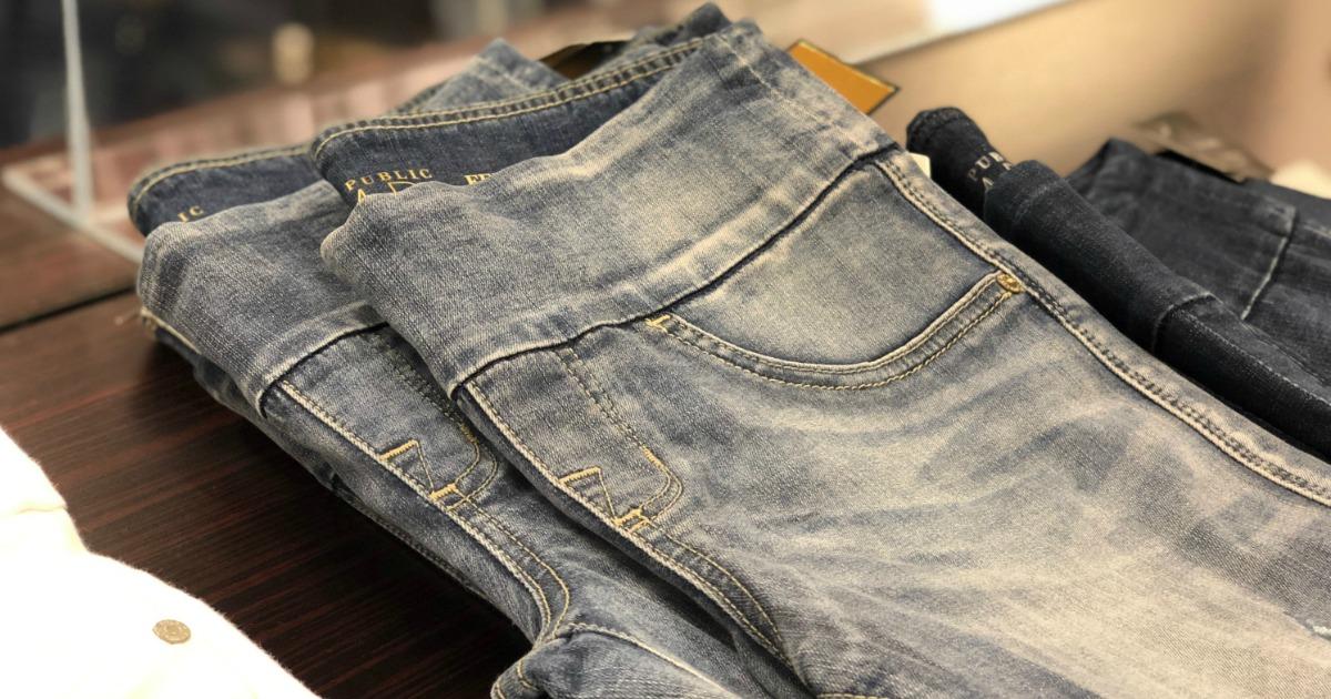 Women's faded denim jeans, folded on shelf in-store