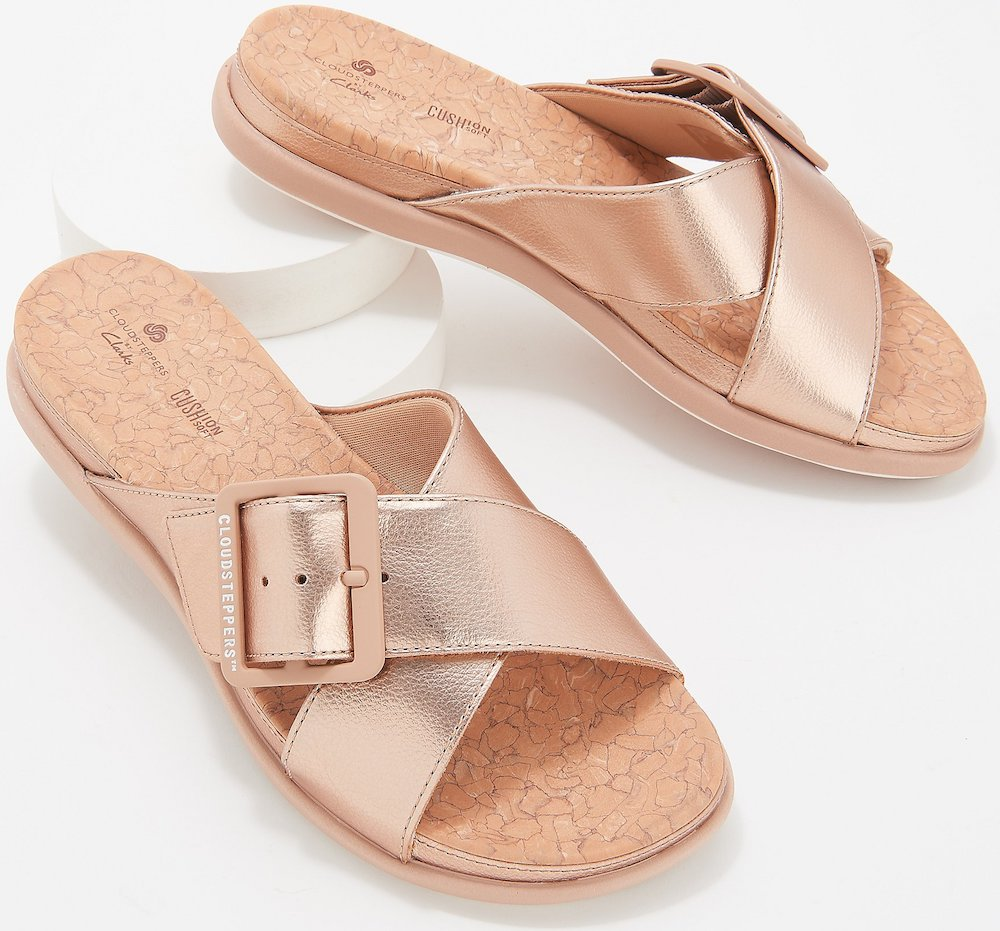 Rose Gold Sandals on display stand