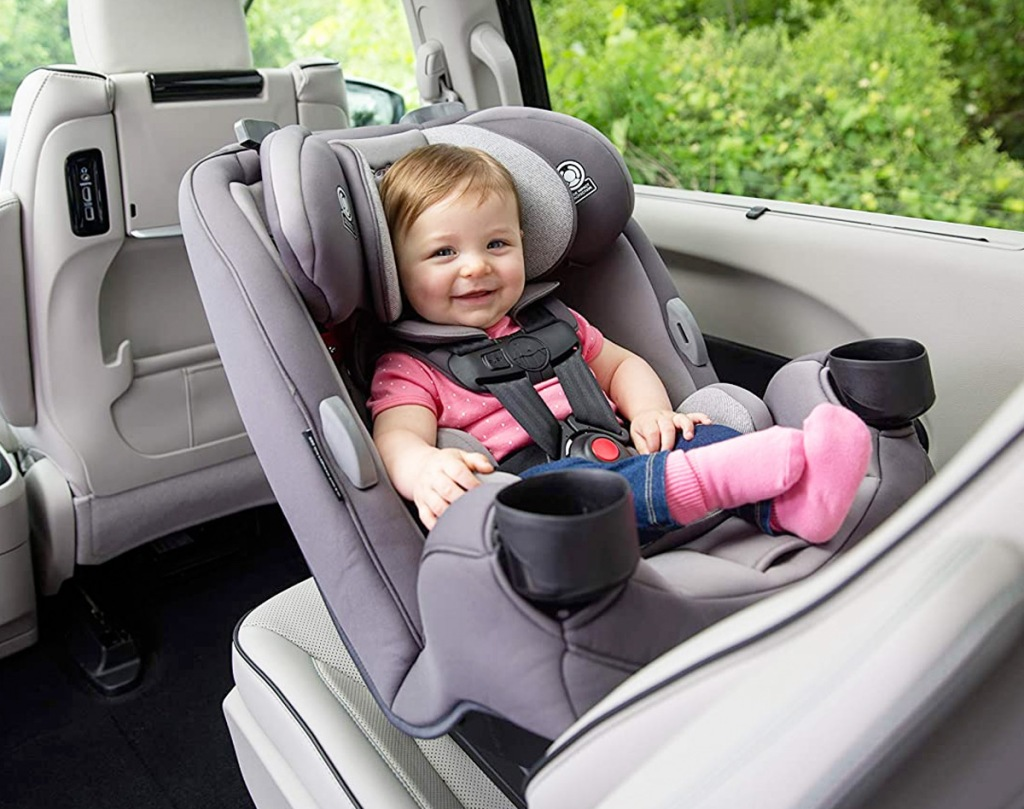 baby seated in a rear facing grey car seat inside car