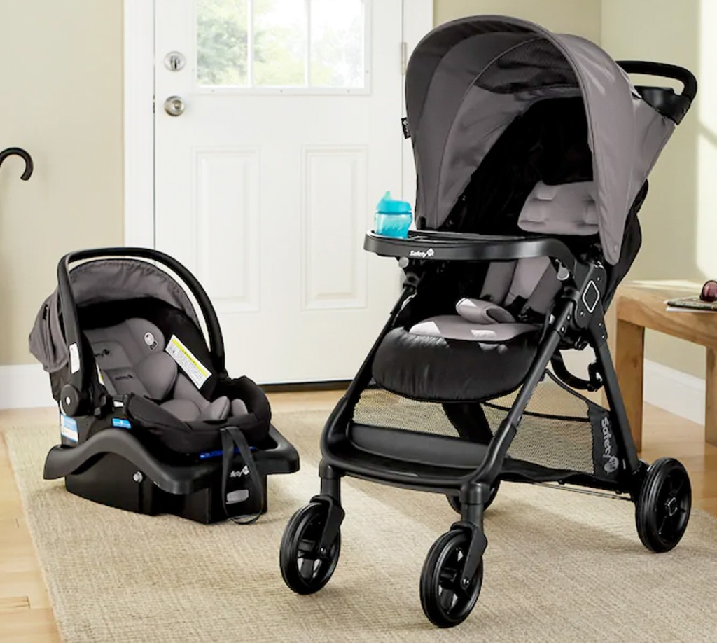 matching black and grey baby stroller and car seat on living room floor