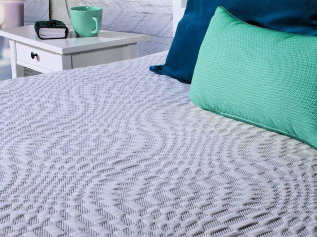 Sealy Spring & Memory Medium-Firm Foam Hybrid Mattress in bedroom