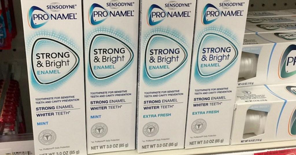 sensodyne toothpaste lined up on a store shelf