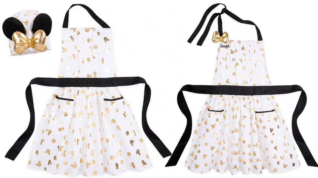 two white aprons with metallic gold polka dots and mickey mouse ears