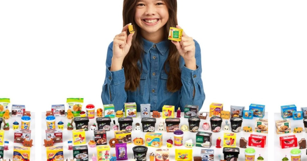 Girl holding up Shopkins Real Littles
