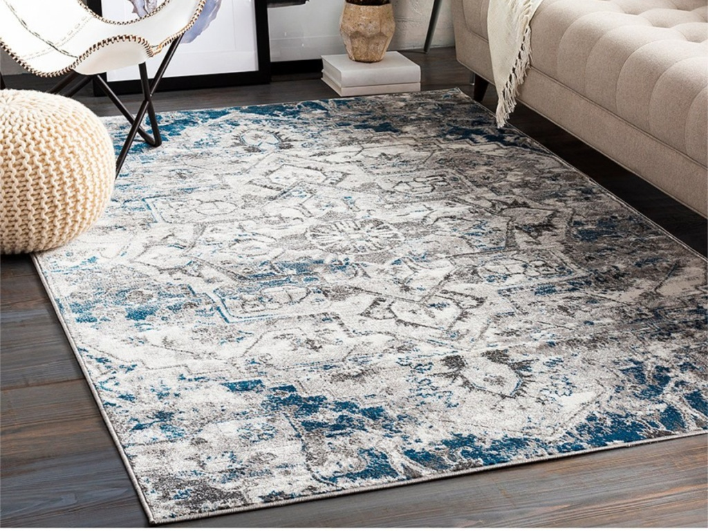 blue area rug on floor in home