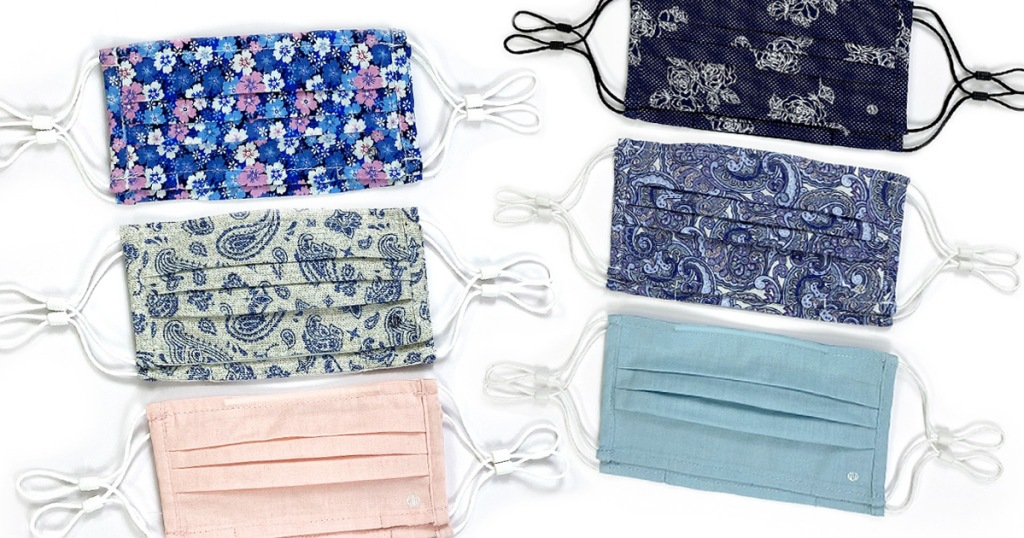 sets of reusable face masks with elastic ear loops in floral prints and solid pink and light blue colors