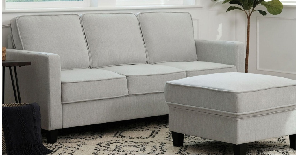 Sofa and Ottoman Set sitting in a small room
