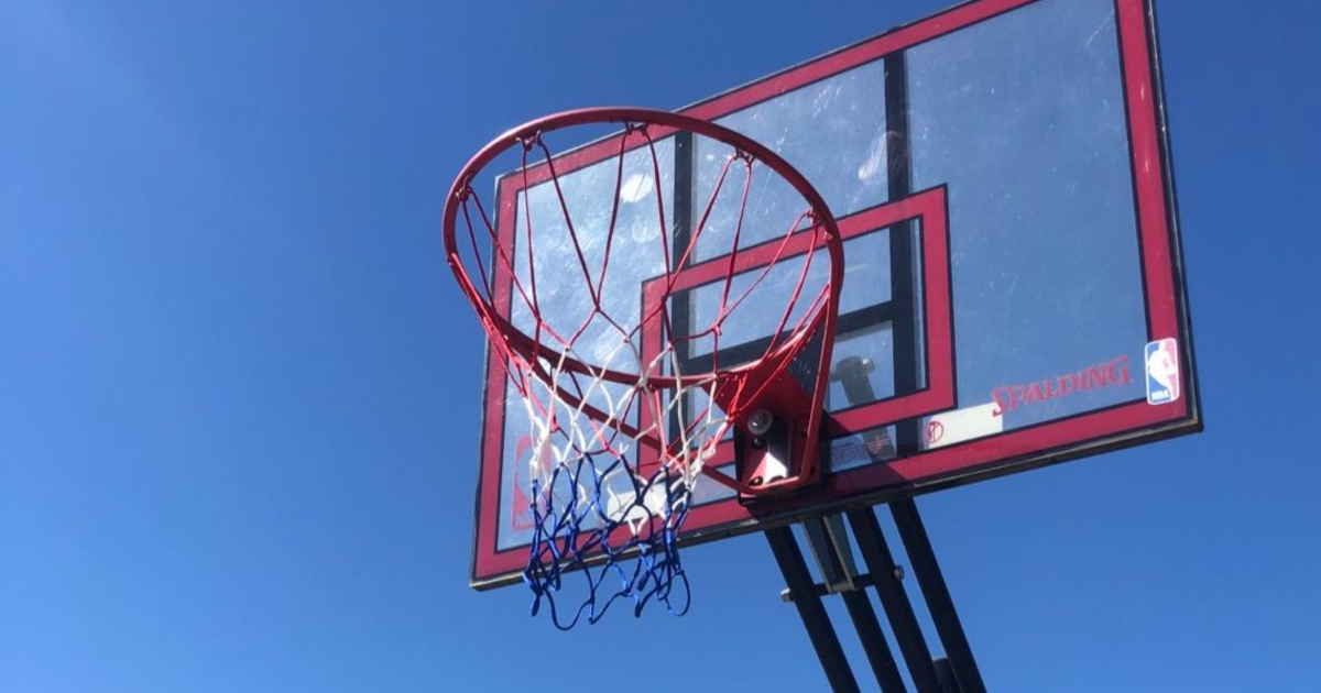red, white, and blue basketball net outside