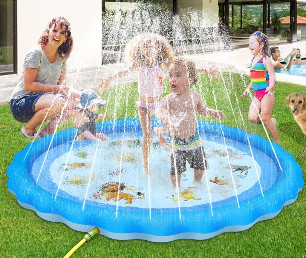 toddlers playing in a blue splash pad on lawn