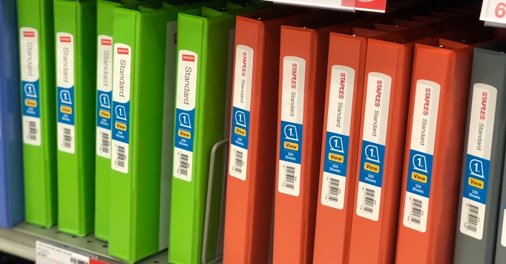 row of staples binders in green and orange