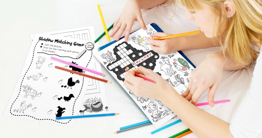kids using coloring pencils to color on black and white coloring pages