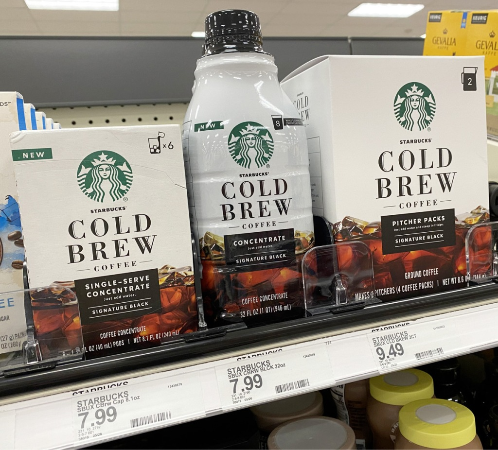 white and brown starbucks cold brew concentrate boxes and bottles on store shelf