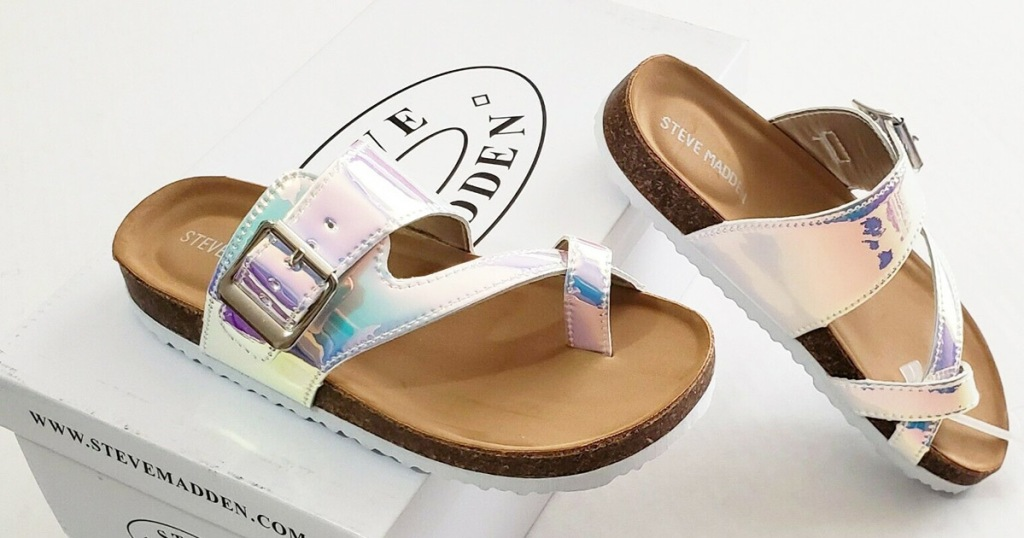 iridescent footbed sandals on top of white steve madden shoe box