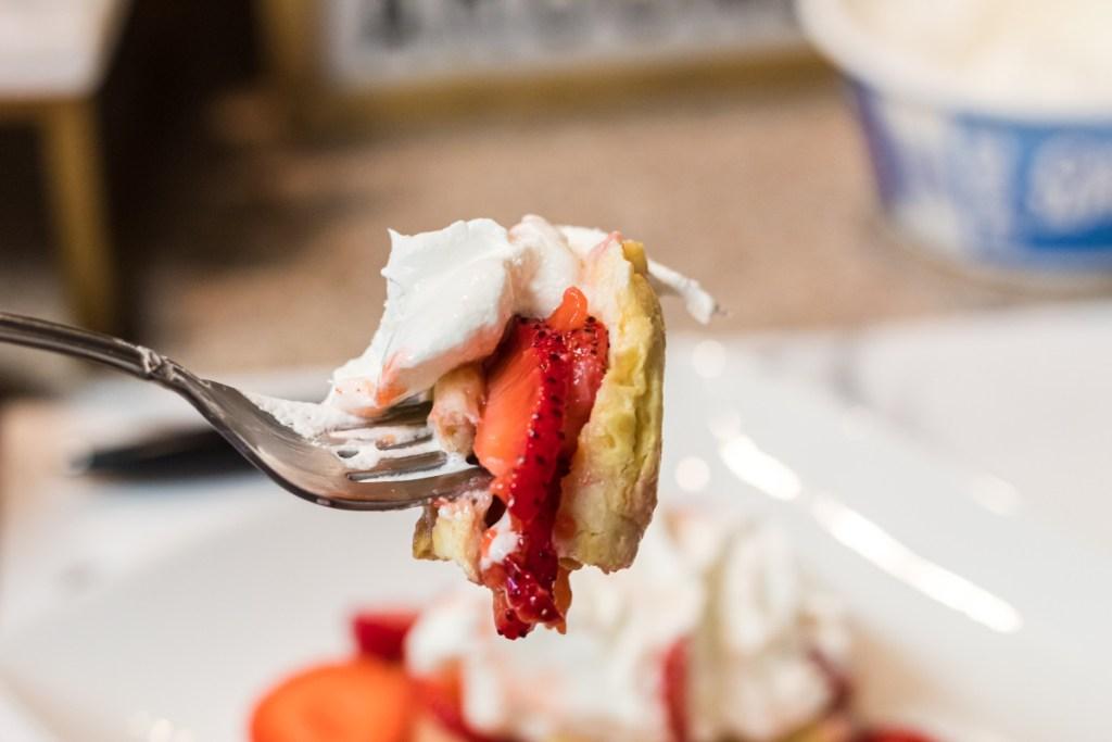 fork full of strawberry shortcake