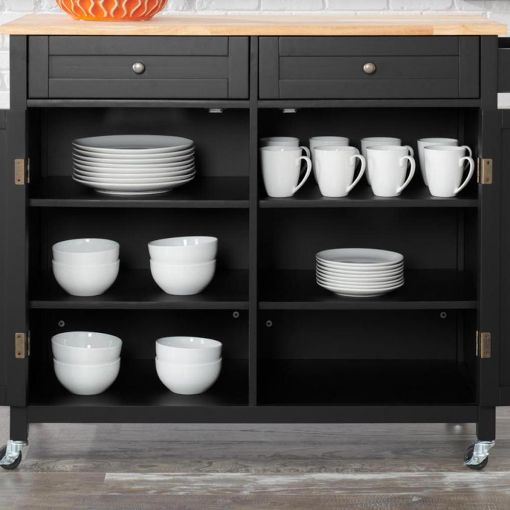 inside of StyleWell Bainport Kitchen Cart with Butcher Block Top with plates and bowls