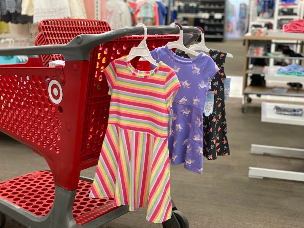 Target cart with three cat and jack dresses hanging from it