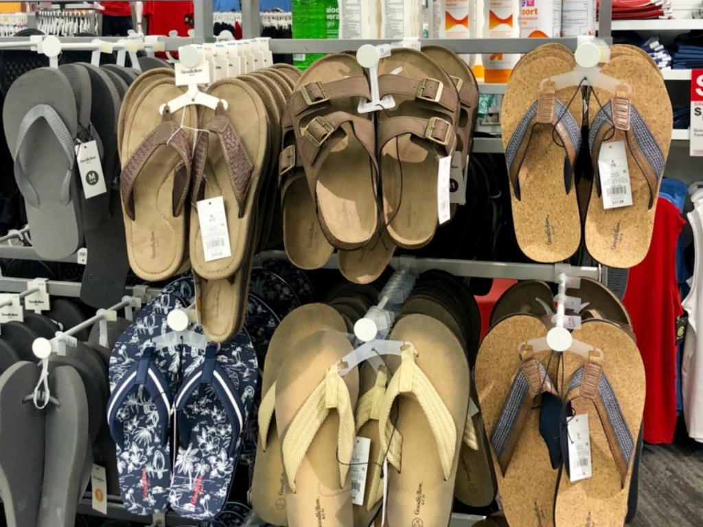 variety of target mens sandals hanging on wall