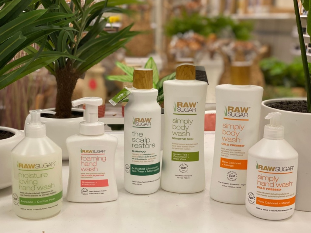 lotions, hand washes, and body wash products on table in store