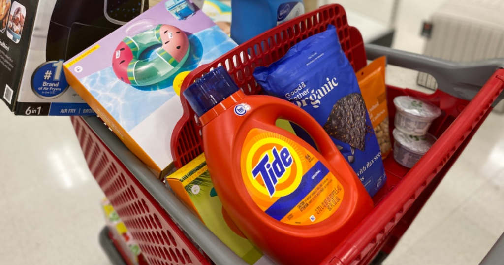 target cart with tide, pool float, chips, and more