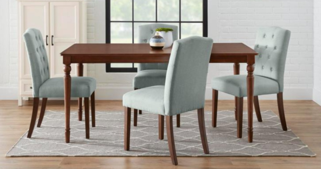 light blue tufted dining room chairs sitting around a brown kitchen table