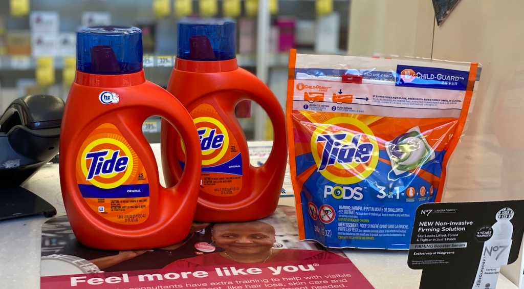 two bottles of laundry detergents and bag of pods