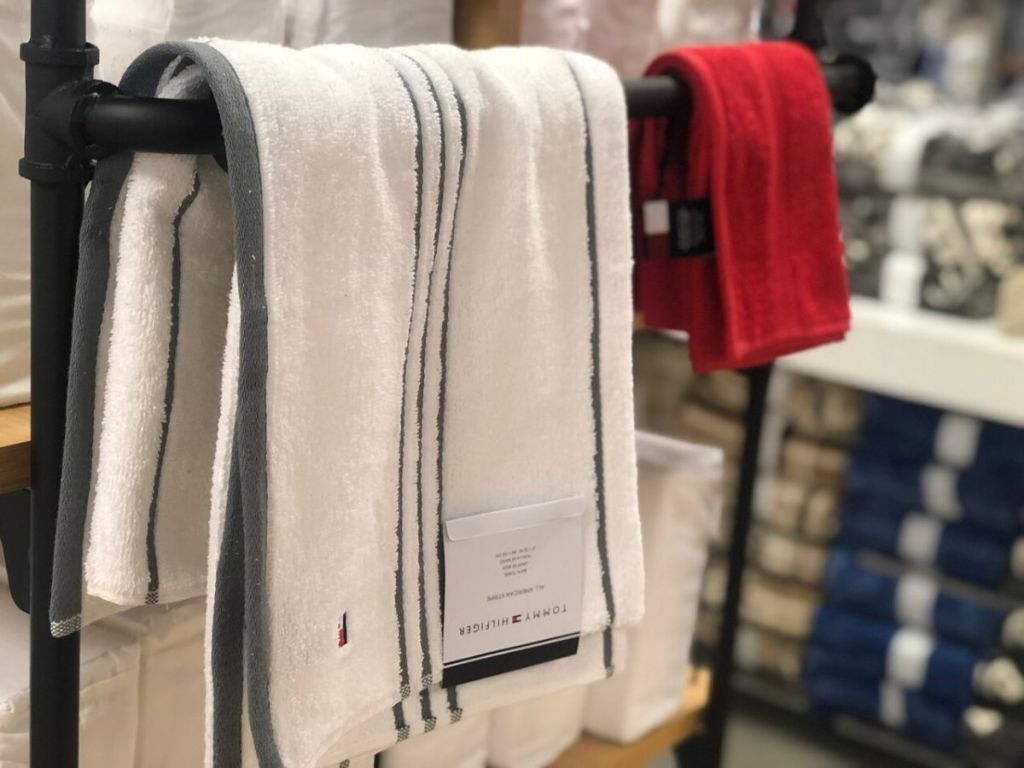 bath towel and hand towel hanging on bar at store