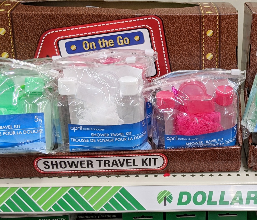 dollar tree store shelf with travel shower kits in green, white, and pink colors