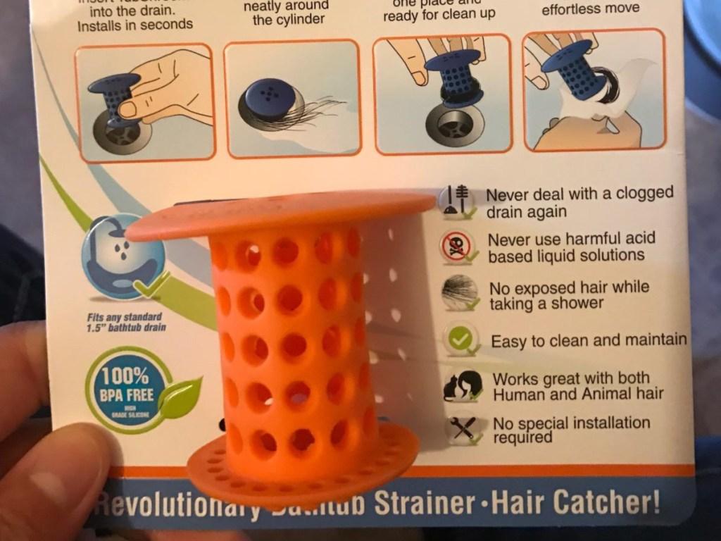 hand holding orange tubshroom in package