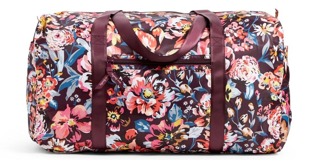 maroon colored floral print duffle bag