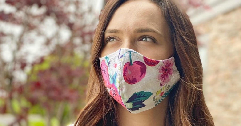 woman wearing a floral print face mask