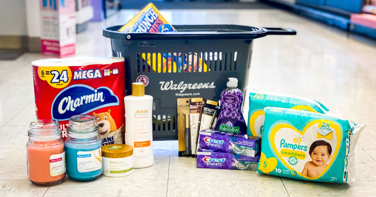 candles, charmin toilet paper, crest toothpaste, dish soap, and pampers diapers on floor in front of walgreens shopping basket