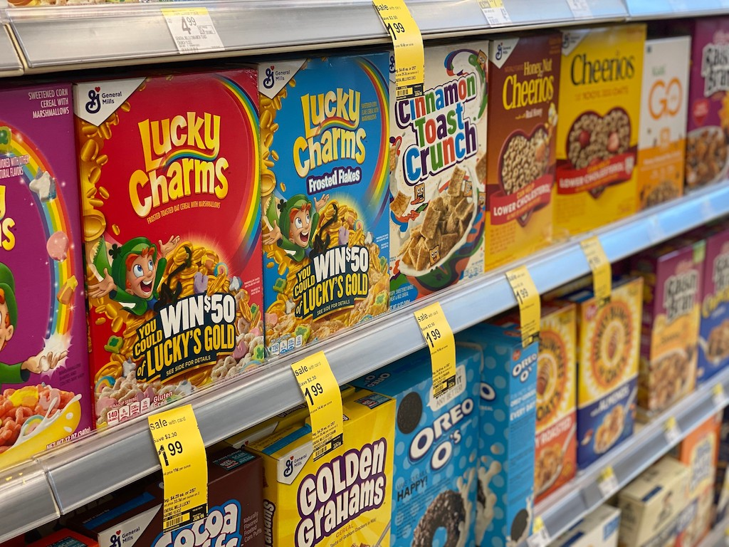 general mills cereals on shelf at Walgreens with sale signs
