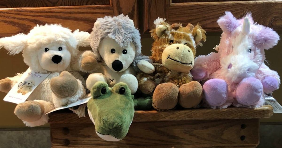 collection of microwavable plush toys on a wooden bench
